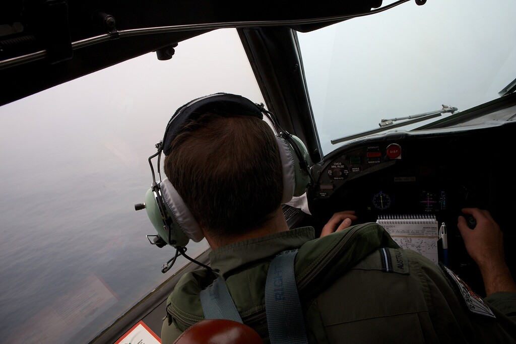 . Co-Pilot, Flying Officer Marc Smith turns his RAAF AP-3C Orion aircraft at low level in bad weather whilst searching for the missing Malaysia Airways Flight MH370 over the Indian Ocean on March 24, 2014. Australian Prime Minister Tony Abbott told Parliament on March 24 that a Royal Australian Air Force P-3 Orion aircraft had located two new objects floating in the southern Indian Ocean.  AFP PHOTO/POOL/RICHARD WAINWRIGHT/AFP/Getty Images