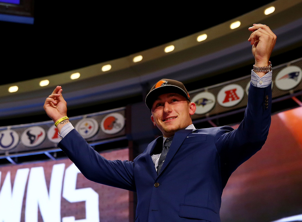 . Johnny Manziel of the Texas A&M Aggies takes the stage after he was picked #22 overall by the Cleveland Browns during the first round of the 2014 NFL Draft at Radio City Music Hall on May 8, 2014 in New York City.  (Photo by Elsa/Getty Images)