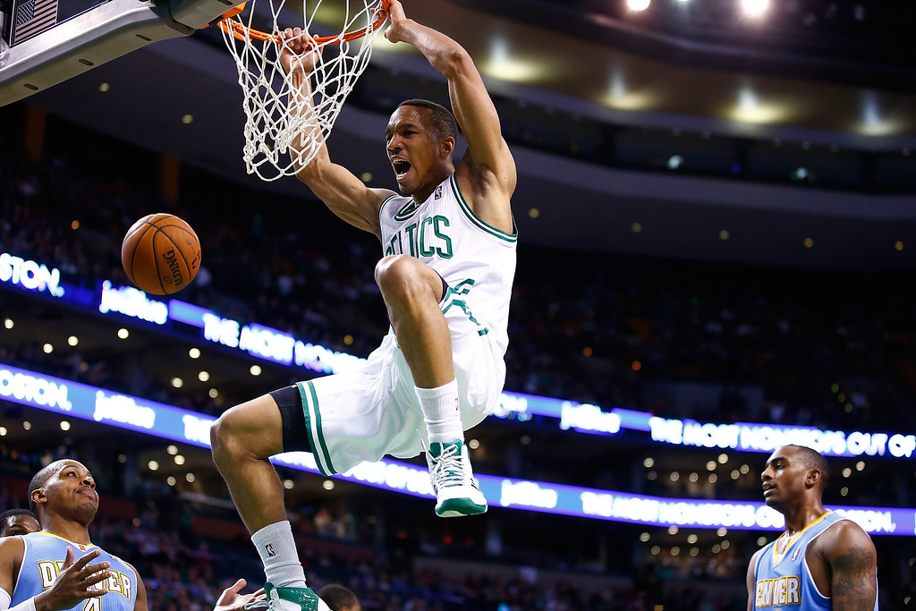 . BOSTON, MA - DECEMBER 06:  Avery Bradley #0 of the Boston Celtics dunks the ball against the Denver Nuggets in the second quarter during the game at TD Garden on December 6, 2013 in Boston, Massachusetts.  (Photo by Jared Wickerham/Getty Images)