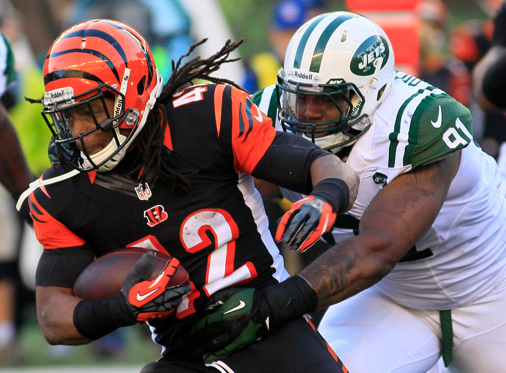 . Cincinnati Bengals running back BenJarvus Green-Ellis (42) is pursued by New York Jets defensive end Sheldon Richardson (91) in the first half of an NFL football game Sunday, Oct. 27, 2013, in Cincinnati. (AP Photo/Tom Uhlman)