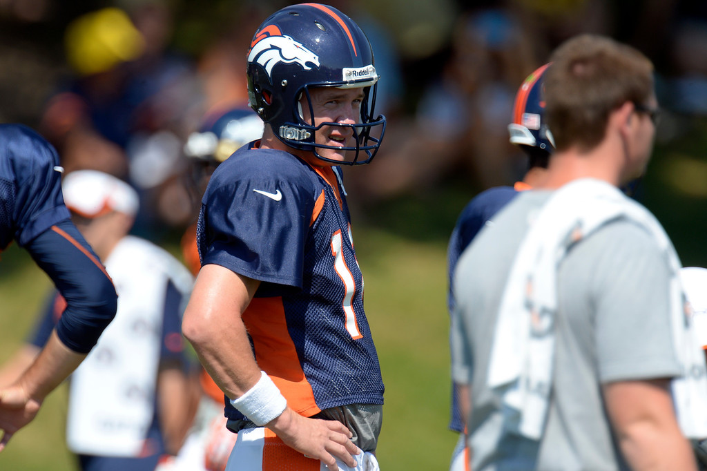 . Denver Broncos quarterback Peyton Manning (18) looks on during drills at practice August 20, 2013 at Dove Valley (Photo by John Leyba/The Denver Post)