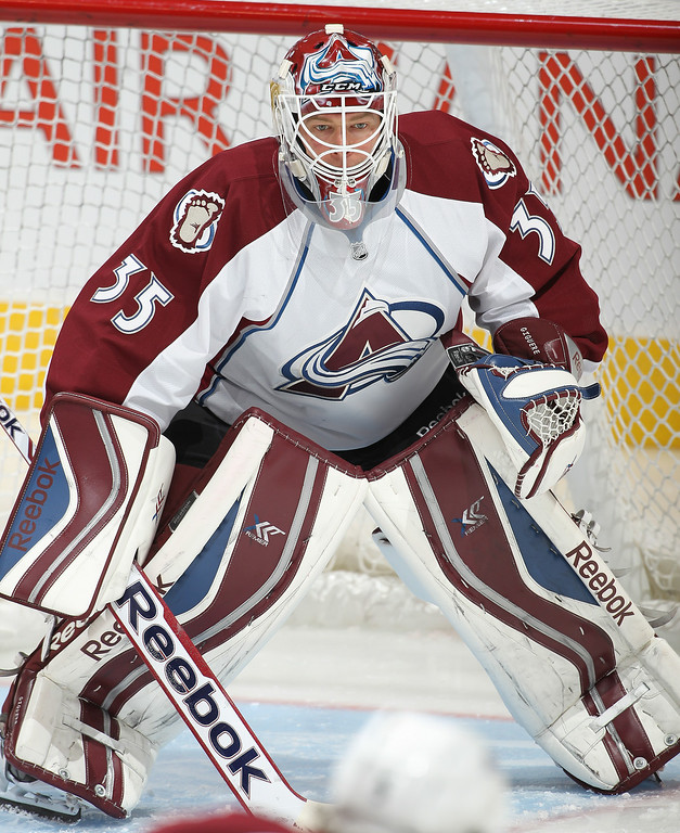. Jean-Sebastian Giguere #35 of the Colorado Avalanche gets set to face a shot in the warm-up prior to playing against the Toronto Maple Leafs during an NHL game at the Air Canada Centre on October 8, 2013 in Toronto, Ontario, Canada. (Photo by Claus Andersen/Getty Images)