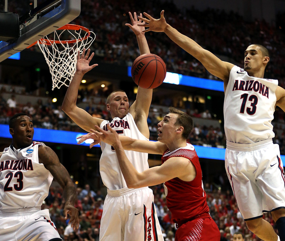 . Sam Dekker #15 of the Wisconsin Badgers goes up for a shot against Rondae Hollis-Jefferson #23, Kaleb Tarczewski #35 and Nick Johnson #13 of the Arizona Wildcats in the first half during the West Regional Final of the 2014 NCAA Men\'s Basketball Tournament at the Honda Center on March 29, 2014 in Anaheim, California.  (Photo by Jeff Gross/Getty Images)