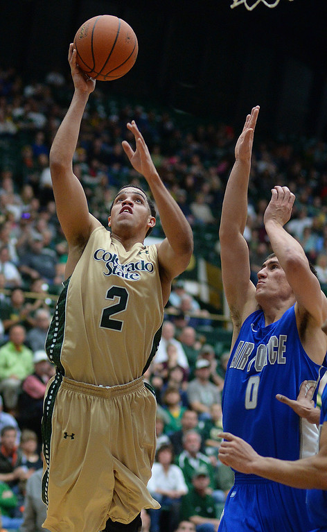 . FORT COLLINS, CO. - JANUARY 18:  Colorado State guard Daniel Bejarano (2) flew to the hoop past Air Force defender Marek Olesinski (0) in the second half. The Colorado State men\'s basketball team defeated Air Force 74-68 at Moby Arena in Fort Collins Saturday night, January 18, 2014. Photo By Karl Gehring/The Denver Post