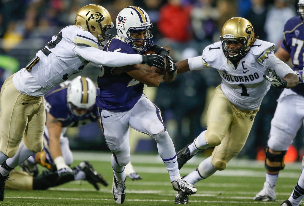 . Running back Bishop Sankey #25 of the Washington Huskies rushes against the Colorado Buffaloes on November 9, 2013 at Husky Stadium in Seattle, Washington. The Huskies defeated the Buffaloes 59-7.  (Photo by Otto Greule Jr/Getty Images)