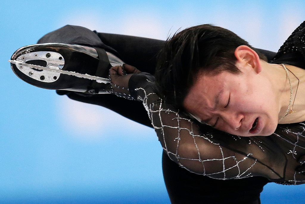 . Denis Ten of Kazakhstan competes in the men\'s short program figure skating competition at the Iceberg Skating Palace during the 2014 Winter Olympics, Thursday, Feb. 13, 2014, in Sochi, Russia. (AP Photo/Bernat Armangue)