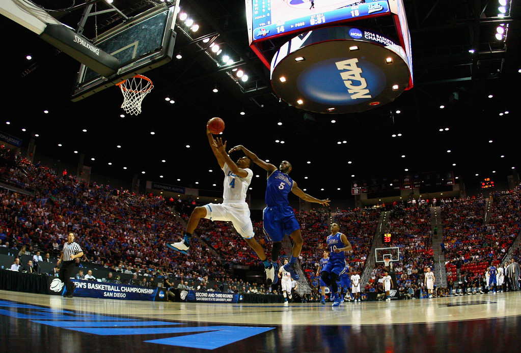 . Tim Peete #5 of the Tulsa Golden Hurricane tries to block Norman Powell #4 of the UCLA Bruins as he lays up a shot in the first half of the game during the second round of the 2014 NCAA Men\'s Basketball Tournament at Viejas Arena on March 21, 2014 in San Diego, California.  (Photo by Donald Miralle/Getty Images)