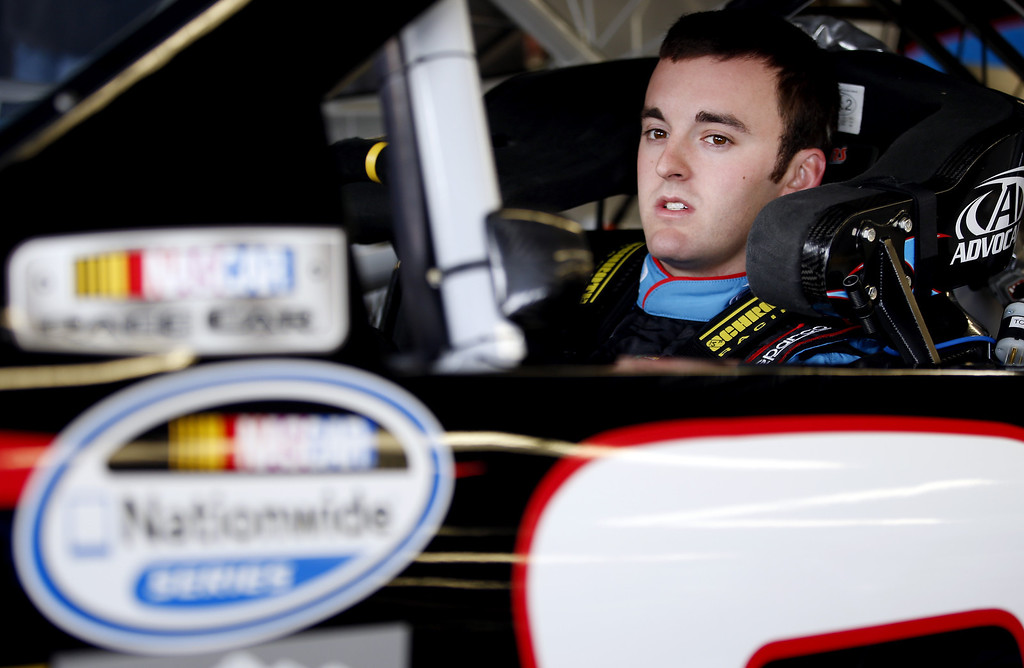 . Austin Dillon, driver of the #3 AdvoCare Chevrolet, sits in his car during practice for the NASCAR Nationwide Series DRIVE4COPD 300 at Daytona International Speedway on February 21, 2013 in Daytona Beach, Florida.  (Photo by Chris Graythen/Getty Images)