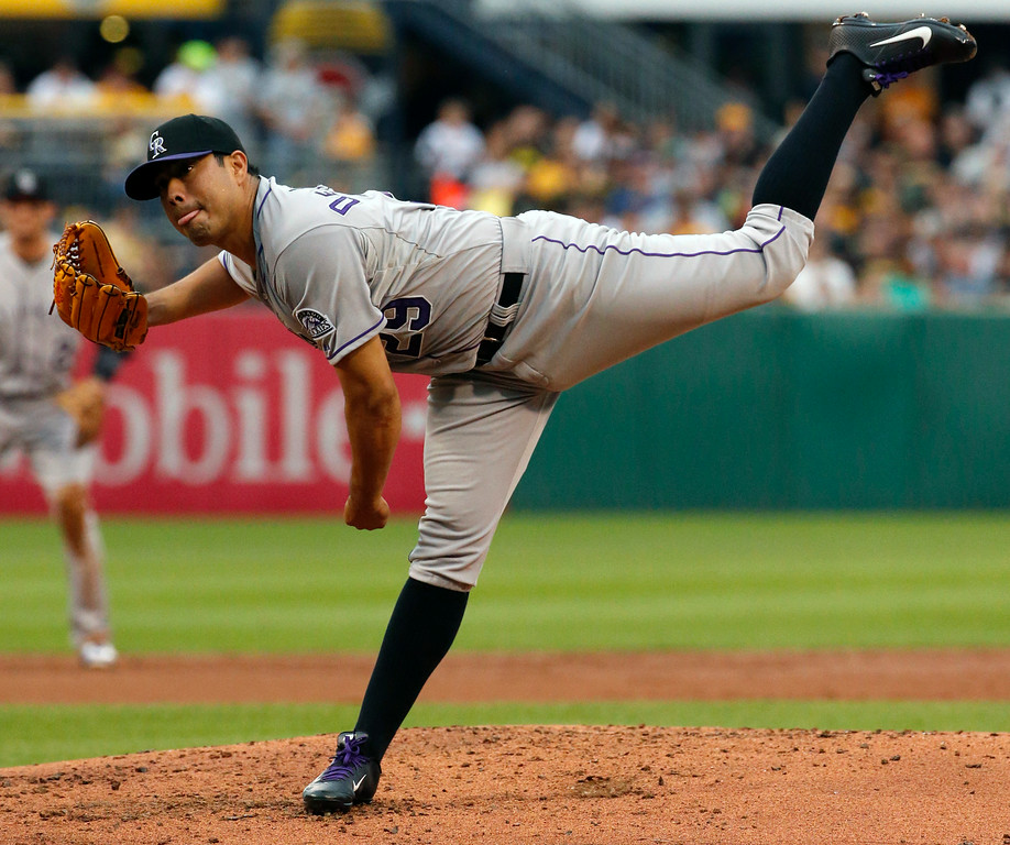 . Colorado Rockies starting pitcher Jorge De La Rosa delivers during the first inning of a baseball game against the Pittsburgh Pirates in Pittsburgh Friday, July 18, 2014. (AP Photo/Gene J. Puskar)