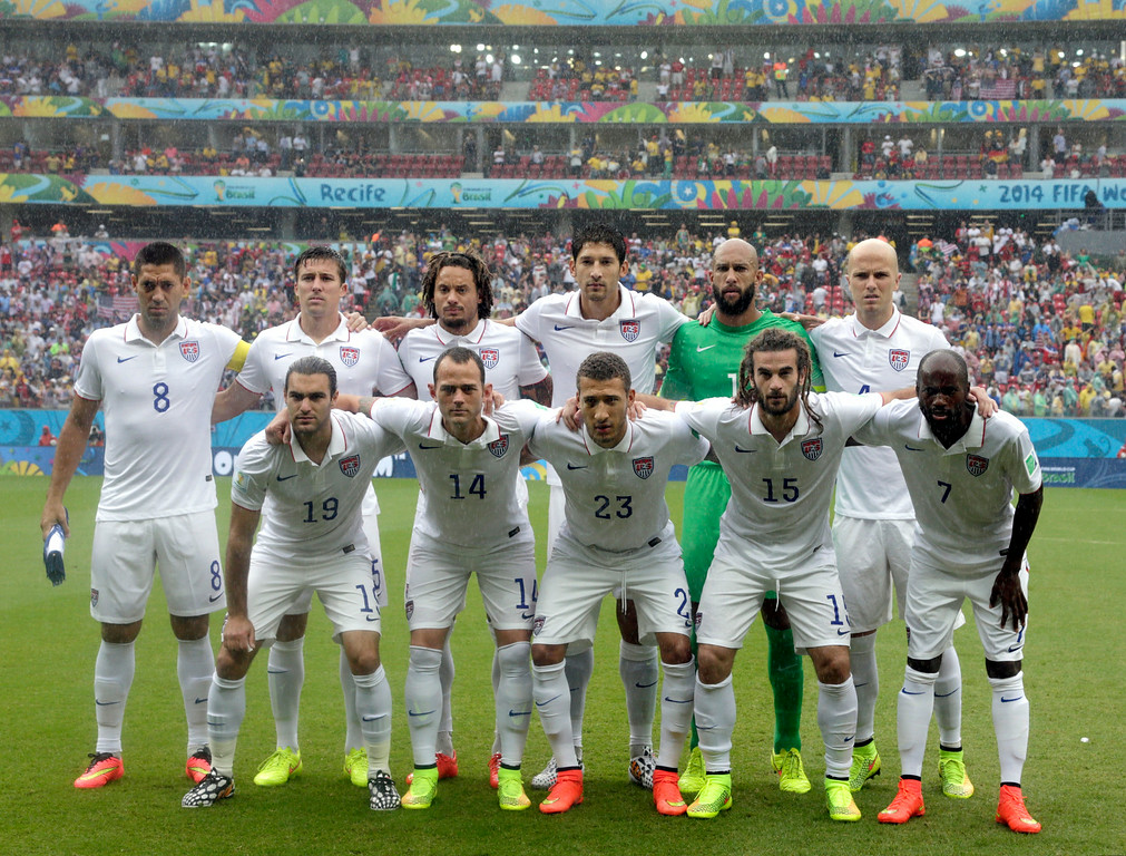 . The USA national team pose before the group G World Cup soccer match between the United States and Germany at the Arena Pernambuco in Recife, Brazil, Thursday, June 26, 2014. (AP Photo/Julio Cortez)