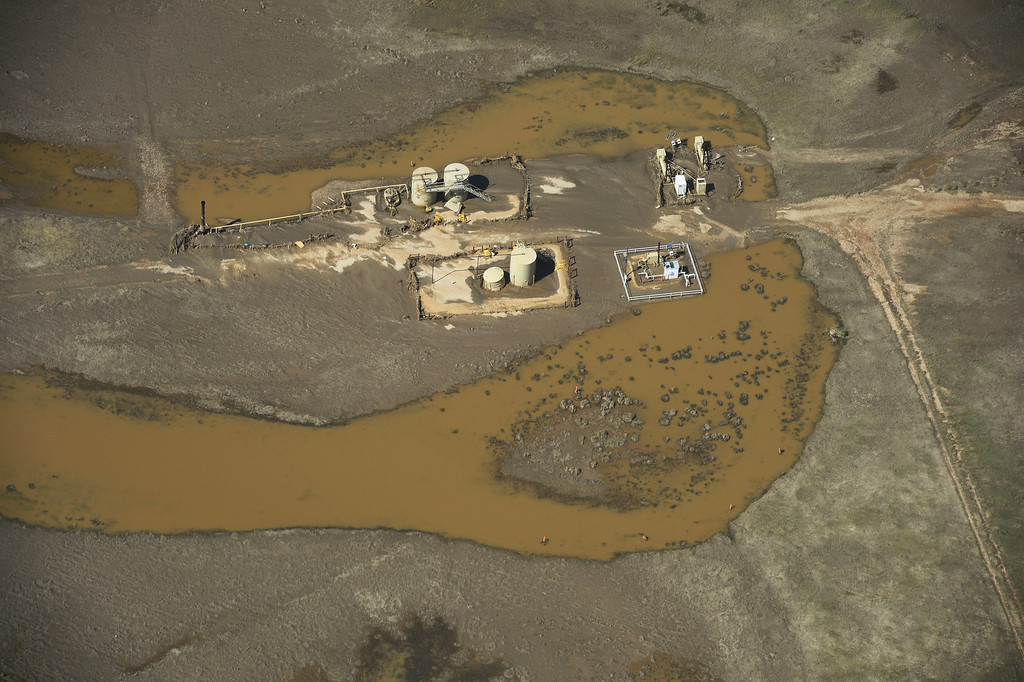 . WELD COUNTY, CO - SEPTEMBER 19: Oil and gas industry equipment is surrounded by flood water in Weld County Colorado near the town of Milliken Thursday afternoon, September 19, 2013.  (Photo By Andy Cross/The Denver Post)