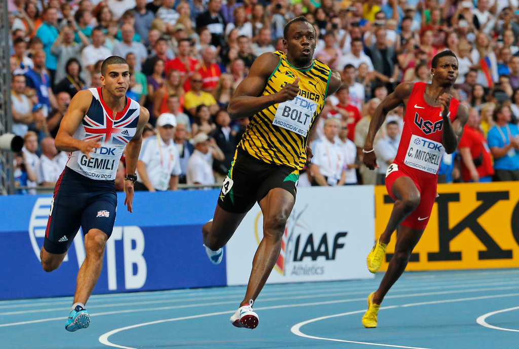 . From left, Britain\'s Adam Gemili, Jamaica\'s Usain Bolt, and United States\' Curtis Mitchell compete in the men\'s 200-meter final at the World Athletics Championships in the Luzhniki stadium in Moscow, Russia, Saturday, Aug. 17, 2013. (AP Photo/Misha Japaridze)
