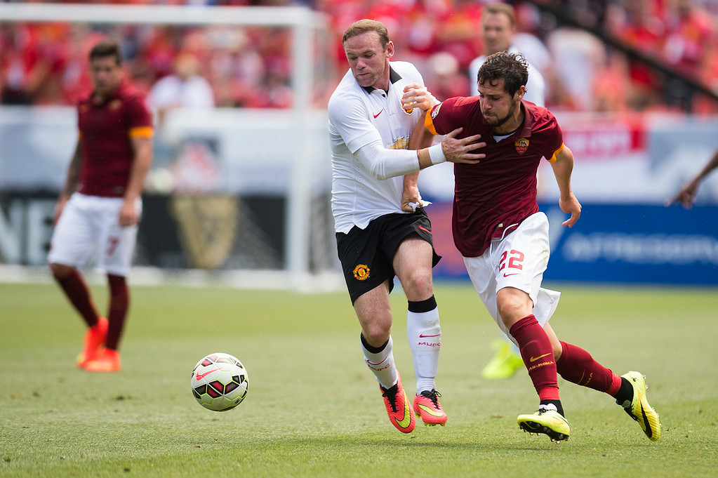 . Wayne Rooney #10 of Manchester United goes after the ball against Mattia Destro #22 of AS Roma during an exhibition match of the Guinness International Champions Cup at Sports Authority Field at Mile High on July 26, 2014, in Denver, Colorado. Manchester United won 3-2. (Photo by Daniel Petty/The Denver Post)