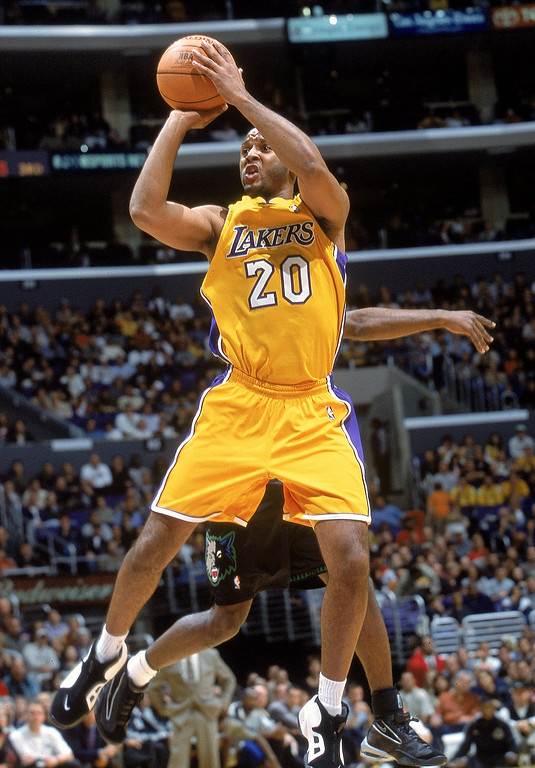 . Brian Shaw #20 of the Los Angeles Lakers makes a jump shot during the game against the Minnesota Timberwolves in Los Angeles, California in April, 2000.   (Stephen Dunn/Allsport)