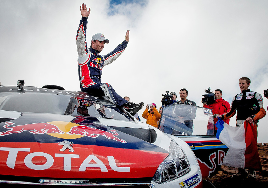 . Unlimited division racer Sebastein Loeb celebrates after shattering the Pikes Peak International Hill Climb course record during his rookie year in the race Sunday, June 30, 2013 with a time of 8 minutes 13 seconds. (Michael Ciaglo, The Gazette)