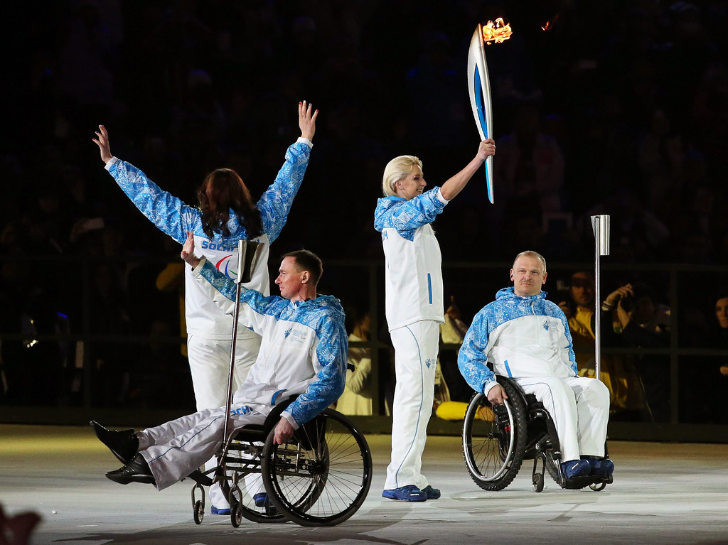 . Russian Paralympic champions carry the Paralympic torch during the Opening Ceremony of the Sochi 2014 Winter Paralympic Games at Fisht Olympic Stadium in Sochi, Russia, 07 March 2014.  EPA/SERGEI CHIRIKOV