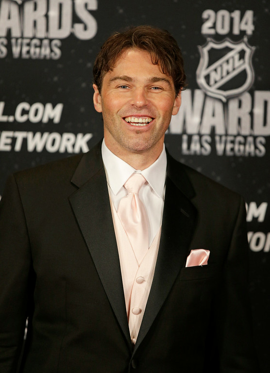. Jaromir Jagr of the New Jersey Devils poses on the red carpet before the NHL Awards on Tuesday, June 24, 2014, in Las Vegas. (AP Photo/John Locher)