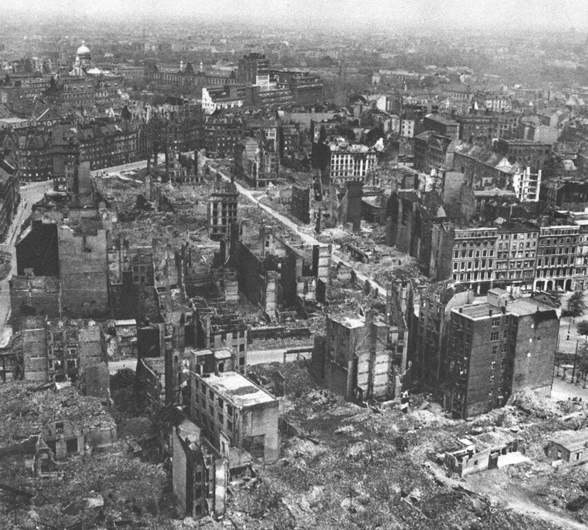 . Hamburg surrendered unconditionally on May 3rd 1945, and was occupied by elements of the 7th Armoured Division and 53rd Division. On the second day after the surrender, the British were in possession of a deserted city, the civilians having been ordered to keep off the streets for 48 hours. Streets wrecked by previous R.A.F. bomber Command Raids were found throughout the city. A view of R.A.F. bomb damage in the area known as New Hamburg, seen from St. Michael\'s Church on May 7, 1945. (AP Photo)
