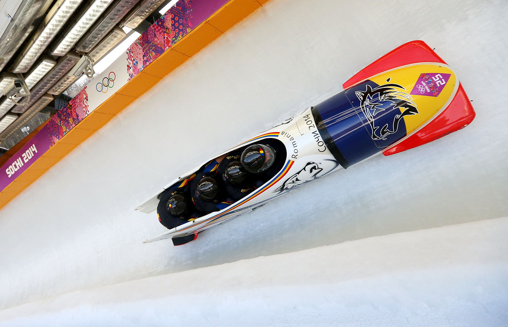 . Pilot Andreas Neagu, Florin Craciun, Paul Muntean and Danut Moldovan of Romania team 1 make a run during the Men\'s Four Man Bobsleigh on day 16 of the Sochi 2014 Winter Olympics at Sliding Center Sanki on February 23, 2014 in Sochi, Russia.  (Photo by Mike Ehrmann/Getty Images)