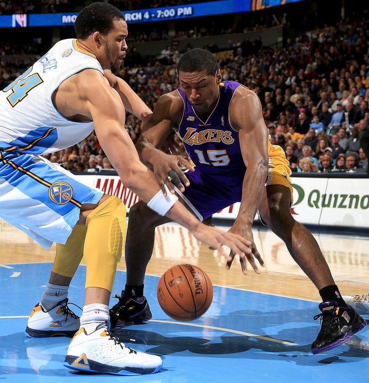 . JaVale McGee #34 of the Denver Nuggets and Metta World Peace #15 of the Los Angeles Lakers vie for a loose ball at the Pepsi Center on February 25, 2013 in Denver, Colorado. NOTE TO USER: User expressly acknowledges and agrees that, by downloading and or using this photograph, User is consenting to the terms and conditions of the Getty Images License Agreement.  (Photo by Doug Pensinger/Getty Images)