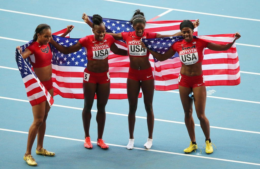 . US Natasha Hastings, US Jessica Beard, US Ashley Spencer and US Francena McCorory celebrate silver after the women\'s 4x400 metres relay final at the 2013 IAAF World Championships at the Luzhniki stadium in Moscow on August 17, 2013.  LOIC VENANCE/AFP/Getty Images