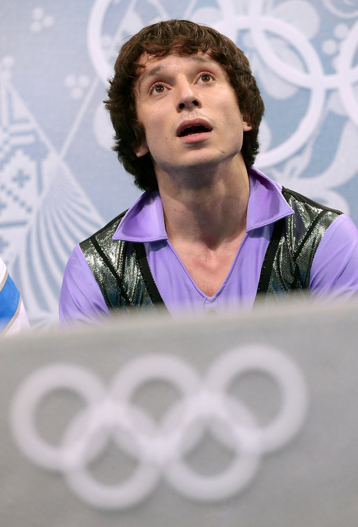. Alexei Bychenko of Israel waits for his results after the men\'s short program figure skating competition at the Iceberg Skating Palace during the 2014 Winter Olympics, Thursday, Feb. 13, 2014, in Sochi, Russia. (AP Photo/Ivan Sekretarev)