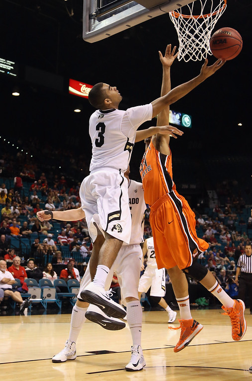 . LAS VEGAS, NV - MARCH 13:  Xavier Talton #3 of the Colorado Buffaloes drives to the basket past Devon Collier #44 of the Oregon State Beavers for a layup in the first half during the first round of the Pac 12 Tournament at the MGM Grand Garden Arena on March 13, 2013 in Las Vegas, Nevada.  (Photo by Jeff Gross/Getty Images)