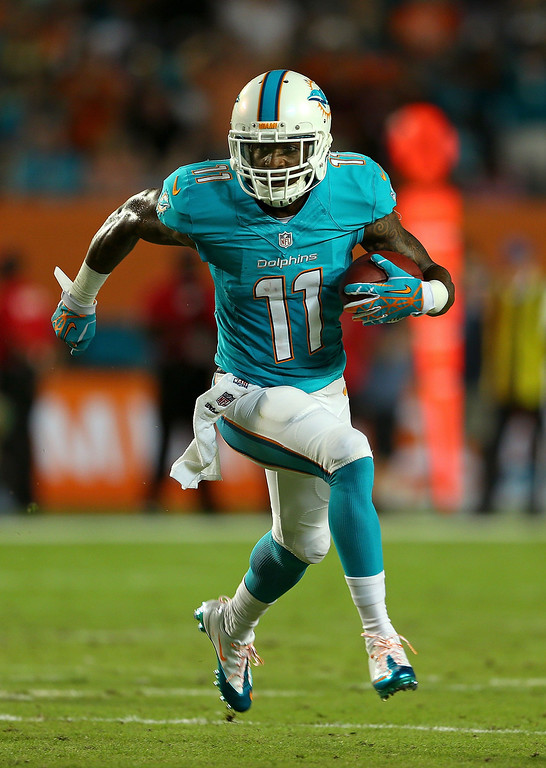 . MIAMI GARDENS, FL - OCTOBER 31: Mike Wallace #11 of the Miami Dolphins runs after a catch during a game against the Cincinnati Bengals at Sun Life Stadium on October 31, 2013 in Miami Gardens, Florida.  (Photo by Mike Ehrmann/Getty Images)