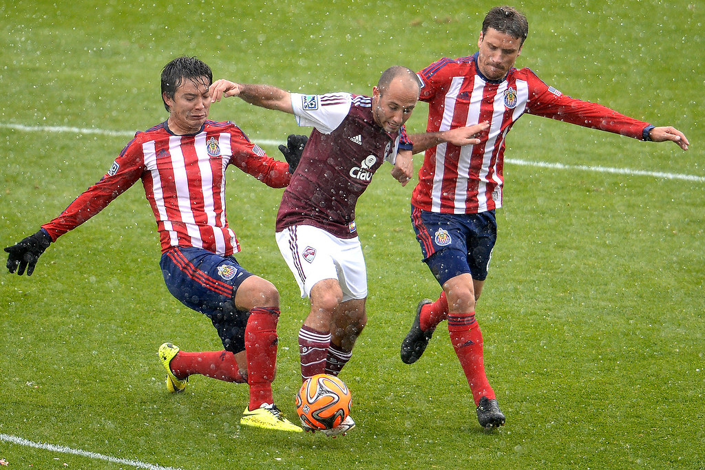 . Nick LaBrocca (2) of Colorado Rapids is defended by Agustin Pelletieri (8) of Chivas U.S.A. and Erick Torres (9) of Chivas U.S.A. during the first half. The Colorado Rapids host Chivas U.S.A. on Sunday, May 11, 2014. (Photo by AAron Ontiveroz/The Denver Post)