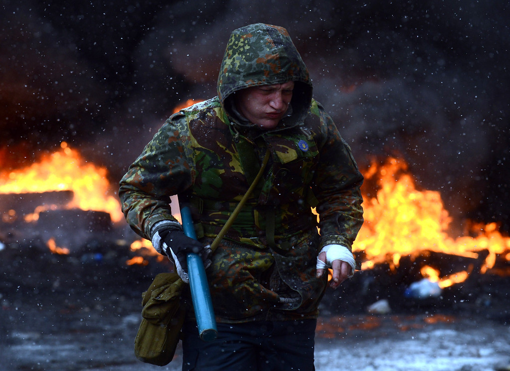 . A protestor runs during clashes with riot police in the centre of Kiev on January 22, 2014.  AFP PHOTO/ VASILY  MAXIMOV/AFP/Getty Images