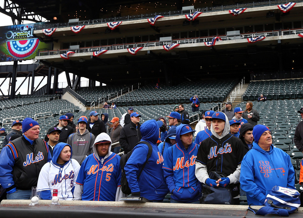 . Fans wait to see the players warm up before Opening Day on March 31, 2014 at Citi Field in the Flushing neighborhood of the Queens borough of New York City.The New York Mets will take on the Washington Nationals in their season opener.  (Photo by Elsa/Getty Images)