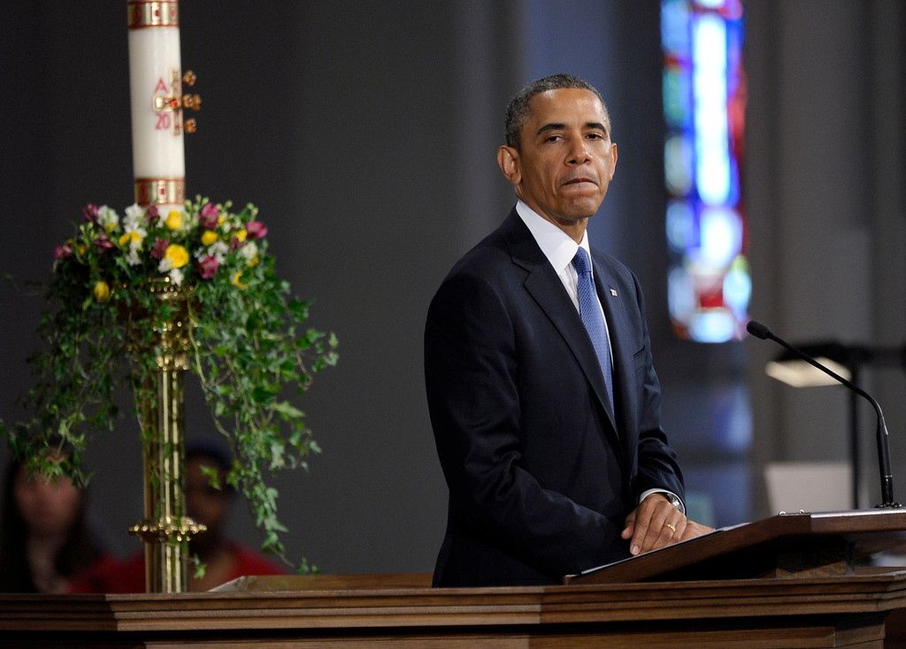 ". President Barack Obama pauses while speaking at the ""Healing Our City: An Interfaith Service\"" at the Cathedral of the Holy Cross in Boston, Thursday, April 18, 2013. (AP Photo/Susan Walsh)"