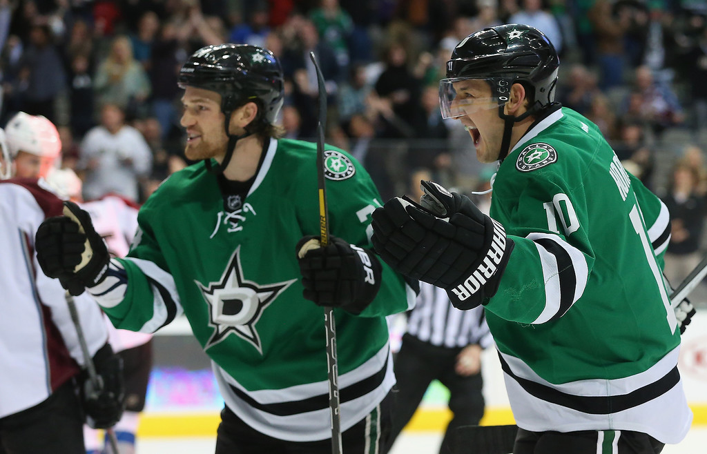 . (L-R) Jordie Benn #24 and Shawn Horcoff #10 of the Dallas Stars celebrate a goal against the Colorado Avalanche in the first period at American Airlines Center on December 17, 2013 in Dallas, Texas.  (Photo by Ronald Martinez/Getty Images)