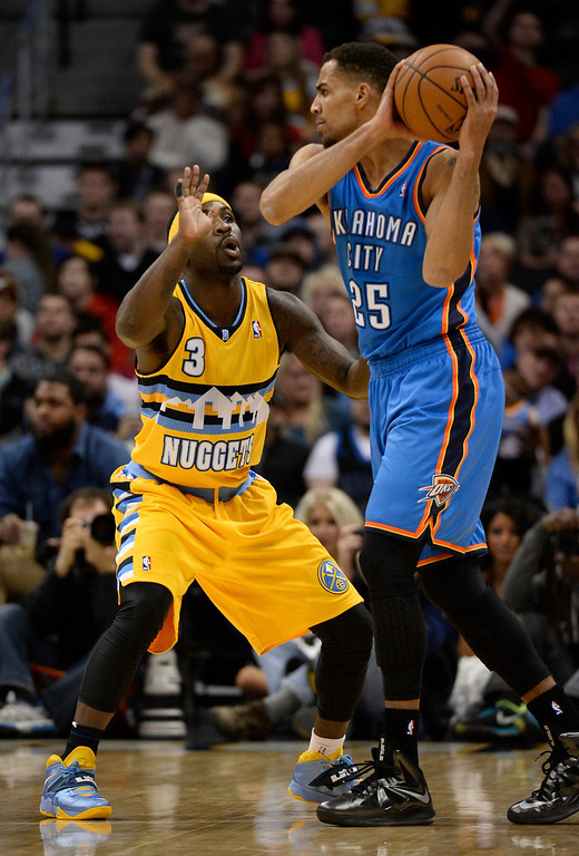 . Denver Nuggets point guard Ty Lawson (3) guards Oklahoma City Thunder shooting guard Thabo Sefolosha (25) during the first quarter December 17, 2013 at Pepsi Center. (Photo by John Leyba/The Denver Post)