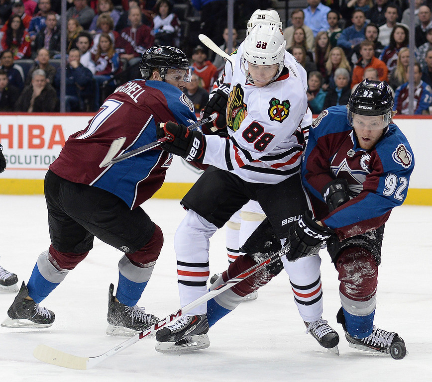 . Colorado wing Gabriel Landeskog (92) reached for the puck in front of Chicago wing Patrick Kane (88) in the first period.  (Photo by Karl Gehring/The Denver Post)