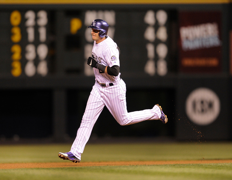 . DENVER, CO. - APRIL 19:  Troy Tulowitzki rounded the bases after homering in the fourth inning. The Colorado rockies hosted the Arizona Diamondbacks at Coors Field Friday night, April 19, 2013.  Photo By Karl Gehring/The Denver Post