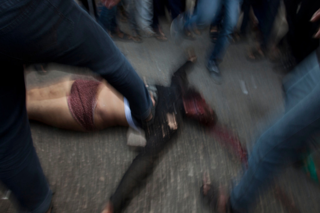 . In this Nov. 20, 2012 photo, a crowd of Palestinians kick the dead body of another Palestinian man suspected of collaboration with Israel and previously executed, in Gaza City. This photo was one in a series of images by Associated Press photographer Bernat Armangue that won the first place prize in the World Press Photo 2013 photo contest for the Spot News series category.  (AP Photo/Bernat Armangue, File)