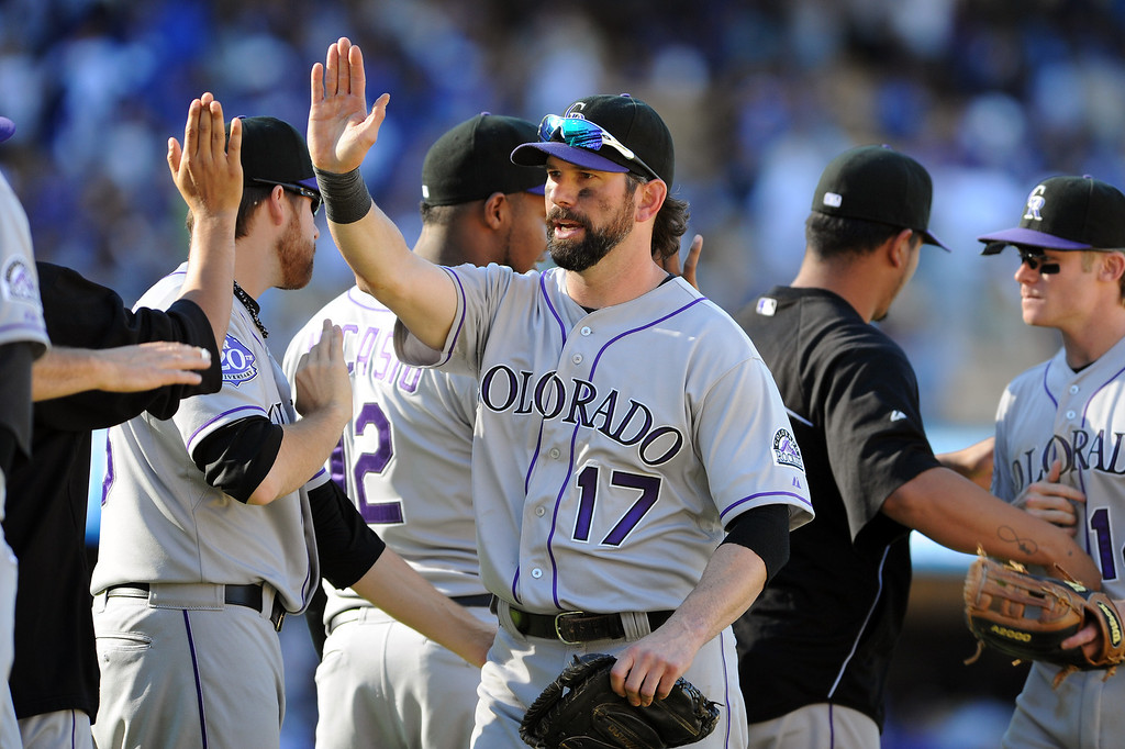 . Colorado Rockies\' Todd Helton, center, is congratulated after they beat the Dodgers 2-1 Sunday, September 29, 2013, at Dodger Stadium. (Photo by Michael Owen Baker/L.A. Daily News)