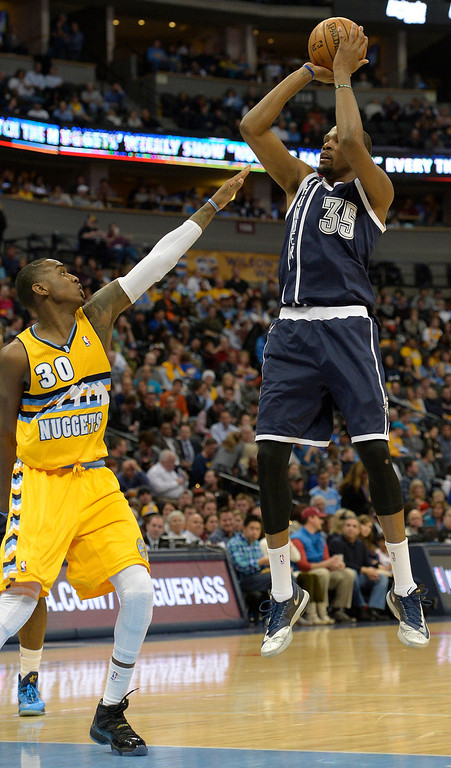 . Oklahoma City Thunder small forward Kevin Durant (35) takes a shot over Denver Nuggets small forward Quincy Miller (30) during the third quarter January 9, 2014 at Pepsi Center. (Photo by John Leyba/The Denver Post)