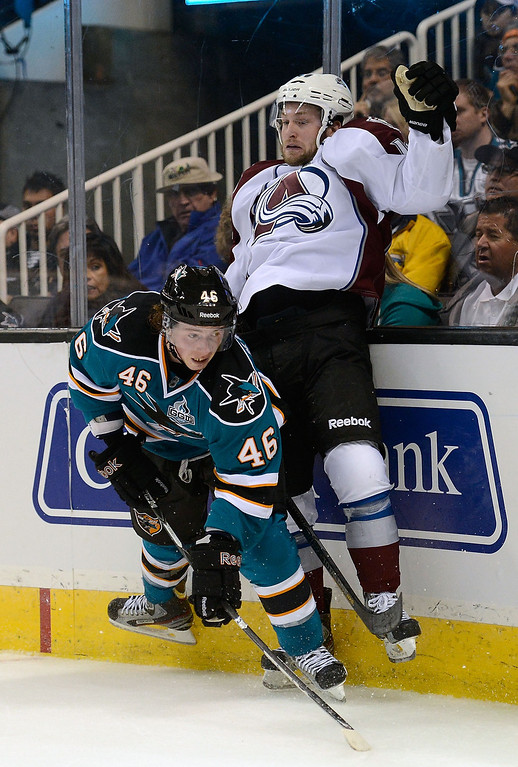 . Tim Kennedy #46 of the San Jose Sharks collides with Mark Olver #40 of the Colorado Avalanche in the second period at HP Pavilion on February 26, 2013 in San Jose, California.  (Photo by Thearon W. Henderson/Getty Images)