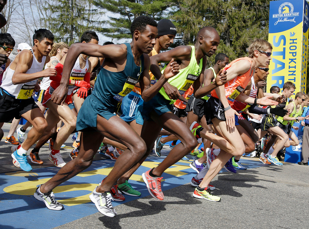 . Elite men runners leave the start line in the 118th running of the Boston Marathon Monday, April 21, 2014 in Hopkinton, Mass. (AP Photo/Stephan Savoia)