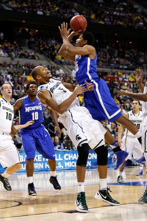 . AUBURN HILLS, MI - MARCH 23:  Geron Johnson #55 of the Memphis Tigers drives for a shot attempt in the second half against Adreian Payne #5 of the Michigan State Spartans during the third round of the 2013 NCAA Men\'s Basketball Tournament at The Palace of Auburn Hills on March 23, 2013 in Auburn Hills, Michigan.  (Photo by Gregory Shamus/Getty Images)