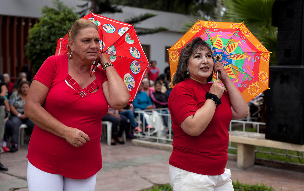. Female inmates perform using umbrellas during an event celebrating Mother\'s Day at a prison for women in Lima, Peru, Friday, May 10, 2013. Peru celebrates Mother\'s Day every May 10. (AP Photo/Martin Mejia)