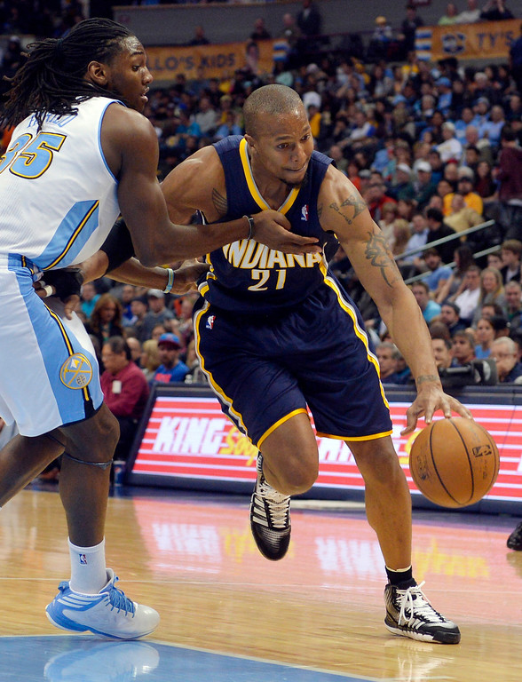 . Indiana Pacers power forward David West (21) drives around Denver Nuggets power forward Kenneth Faried (35) during the third quarter of an NBA basketball game Saturday, Jan. 25, 2014, in Denver. (AP Photo/Jack Dempsey)