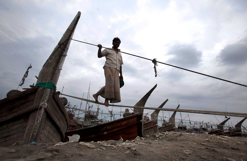 . A Bangladeshi fisherman uses an anchored ropes of his boat to come on the banks of the river Kornofuli, in Chittagong, Bangladesh, Wednesday, May 15, 2013. Cyclone Mahasen is expected to make landfall early Friday. The storm was heading toward Chittagong, Bangladesh, but could shift east and deliver a more direct hit on Rakhine state in Myanmar. (AP Photo/ A.M.Ahad)