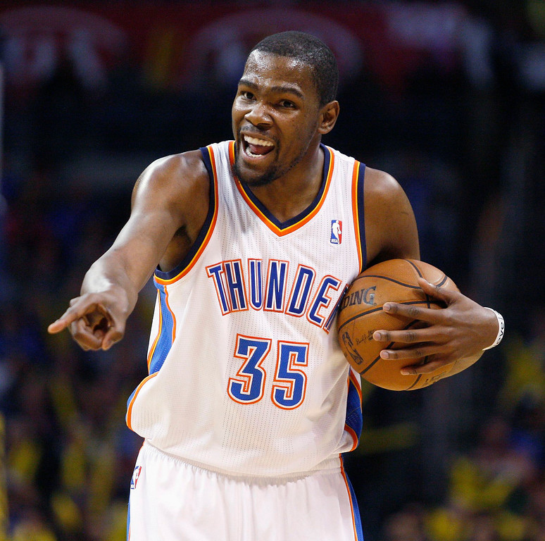 . Oklahoma City Thunder forward Kevin Durant shouts instructions to a teammate as he runs the offense against the Denver Nuggets in the second half of their NBA basketball game in Oklahoma City, Oklahoma January 16, 2013. REUTERS/Bill Waugh