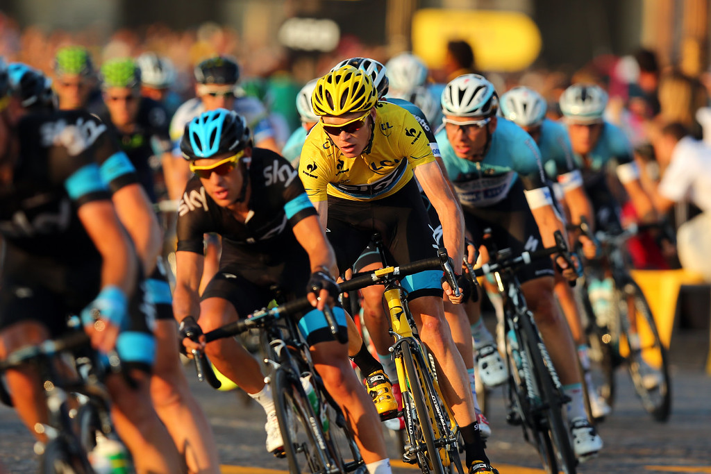. Chris Froome of Great Britain and SKY Procycling (C) rides in the wheel of teammate Richie Porte of Australia during the twenty first and final stage of the 2013 Tour de France, a processional 133.5KM road stage ending in an evening race around the Champs-Elysees, on July 21, 2013 in Paris, France.  (Photo by Bryn Lennon/Getty Images)