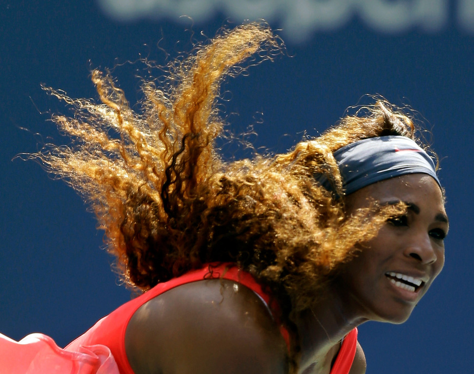 . Serena Williams follows through on a serve to Galina Voskoboeva, of Kazakhstan, during the second round of the 2013 U.S. Open tennis tournament, Thursday, Aug. 29, 2013, in New York. (AP Photo/Kathy Willens)
