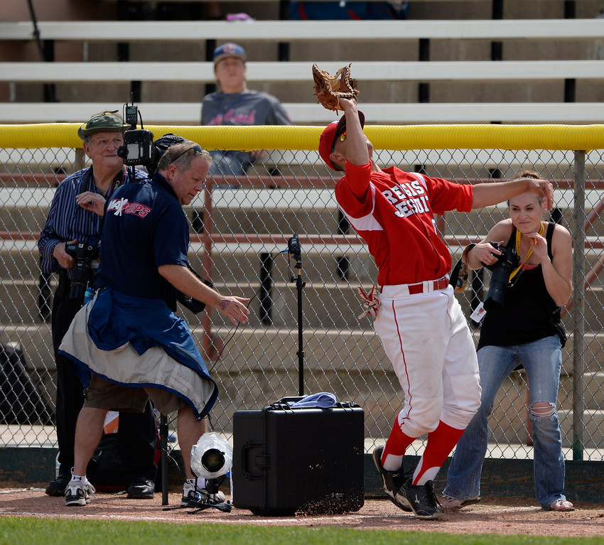 . DENVER, CO. - MAY 23: Regis first baseman, Reagan Todd, catches a pop fly in the photo well hit by Michael Dunnbecke, Mountain View in the first inning during the Colorado State 5A baseball playoffs at All City Field Friday afternoon, May 23, 2014. (Photo By Andy Cross / The Denver Post)