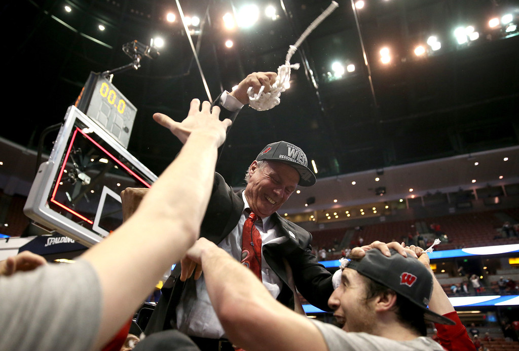 . Head coach Bo Ryan of the Wisconsin Badgers celebrates with Frank Kaminsky #44 after he cuts down the net after defeating the Arizona Wildcats 64-63 in overtime during the West Regional Final of the 2014 NCAA Men\'s Basketball Tournament at the Honda Center on March 29, 2014 in Anaheim, California.  (Photo by Jeff Gross/Getty Images)